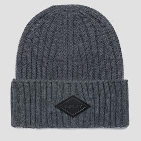 Solid-coloured ribbed beanie