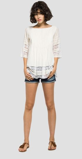 Pleated blouse with lace inserts