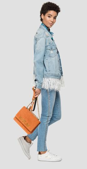 Denim jacket with feathers