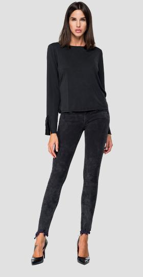 Sweater with neckline on the back