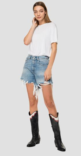 Used denim shorts with fringes